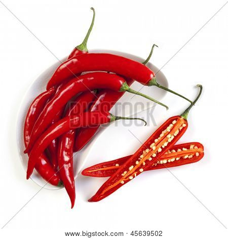 Red hot chili peppers, whole and cut, isolated on white.  Overhead view.