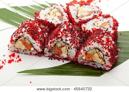 Maki Sushi - Sushi Roll with Fresh Salmon, Cucumber, Tamago and Feta Cheese inside. Tobiko outside