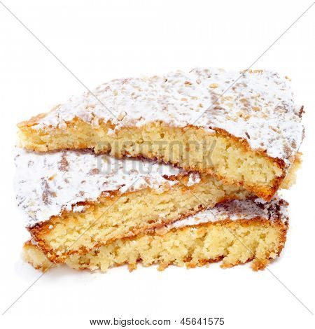 some pieces of Tarta de Santiago, typical almond pie from Spain, on a white background