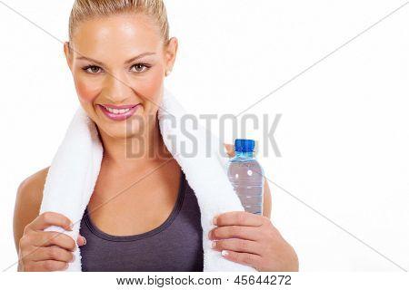 young woman holding water bottle after workout on white background