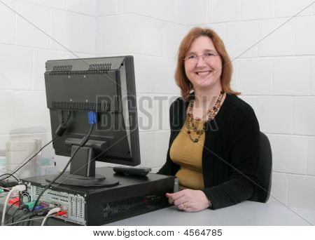 Teacher At Computer