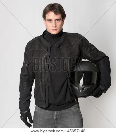 Bicker in black holding his crash helmet