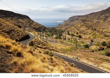 Winding road through Barranco de Guayedra, Grand Canary, Puerto de las Nieves in background