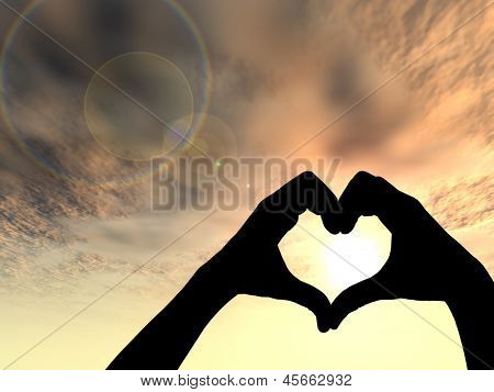 Concept or conceptual heart shape or symbol made of human or woman and man hand silhouette over a sky at sunset background,metaphor to love,valentine,romantic,couple,wedding,romance,summer or sunrise