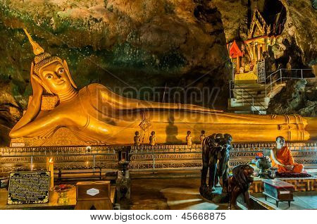 PHUKET ISLAND, THAILAND - AUGUST 12, 2008: statue of Reclining Buddha in buddhist suwankuha temple phang nga in Phuket island in Thailand on august 8th, 2008