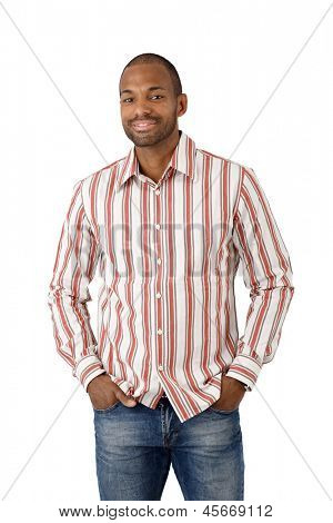 Portrait of happy ethnic guy in striped shirt, cutout on white.