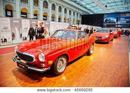 MOSCOW - APR 4: Legendary Volvo P1800,  SUV XC60 and S60 sport sedan at stand in Gostiny Dvor during Volvo Fashion Week, April 4, 2012, Moscow, Russia.