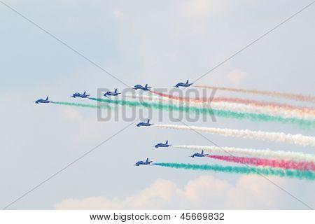 ZHUKOVSKY - AUGUST 12: Military italian aircrafts let smoke of colors of Italian flag at airshow devoted to 100 anniversary of Russian Air Forces, August 12, 2012 in Zhukovsky, Moscow region, Russia.