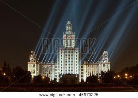 MOSCOW -  AUG 28: Evening view of the Moscow State University with a large number of projectors on August 28, 2011 in Moscow Russia. With the spire height - 240 m