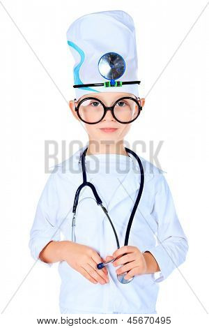 Portrait of a cute boy in big spectacles playing doctor with a stethoscope. Isolated over white.