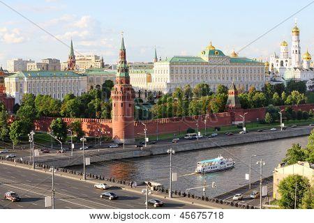 Ship on Moskva river, Vodovzvodnaya Tower of Kremlin, Grand Kremlin Palace, Ivan Great Bell in Moscow, Russia.