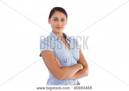 Confident businesswoman crossing her arms on white background