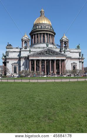 ST. PETERSBURG, RUSSIA - MAY 9: People on St. Isaac square against St. Isaac's Cathedral in St. Petersburg, Russia on May 9, 2012