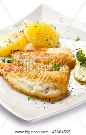 Fish dish - fried fish fillets, boiled potatoes and vegetable salad
