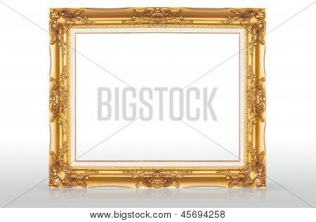 Golden Picture Frame With Reflection On Floor
