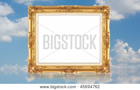 Golden Picture Frame With Reflection On Water With Blue Sky