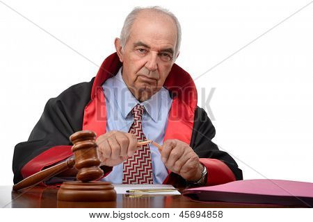 Senior adult judge breaking pencil meaning capital punishment according to some judiciary systems