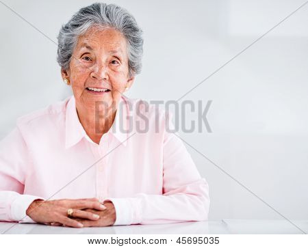 Portrait of a beautiful elder woman at home smiling