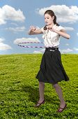stock photo of hulahoop  - Young beautiful woman with a hula hoop - JPG