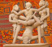 image of kama  - Erotic sculptures from Khajuraho India depicting positions from the Kama Sutra set against colorful Indian backgrounds - JPG