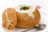 pic of clam  - Sourdough bun of delicious hot clam chowder garnished with bacon and dill - JPG