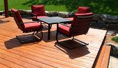 image of pergola  - Backyard deck design with furniture on freshly stained deck - JPG