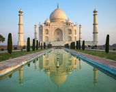 stock photo of fountain grass  - A perspective view on Taj Mahal mausoleum with reflection in water - JPG