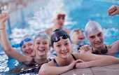 picture of swimming  - happy teen  group  at swimming pool class  learning to swim and have fun - JPG