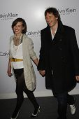 LOS ANGELES - JAN 28: Milla Jovovich, Paul W S Anderson at the Calvin Klein Collection & LA Nomadic