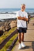 sporty middle aged man portrait at the beach in the morning