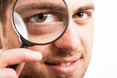 image of supervision  - Man searching for something using a magnifying glass - JPG