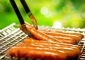 stock photo of barbecue grill  - Grilled Sausage on the flaming Grill - JPG