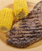 A Grilled Rib Eye Steak With Corn