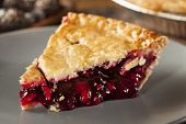 stock photo of pie  - Homemade Organic Berry Pie with blueberries and blackberries - JPG