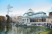MADRID - MARCH 11: Tourists walk near pond and Glass Pavilion in Retiro Park, on March 11 2012 in Ma
