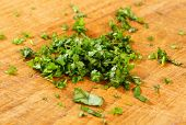 shradded parsley on a wooden cutting board