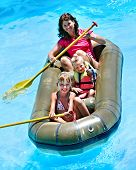 picture of inflatable slide  - Family with children  ride  rubber boat at  swimming pool  - JPG