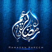 stock photo of kareem  - Arabic Islamic calligraphy of shiny text Ramadan Kareem or Ramazan Kareem on blue background - JPG