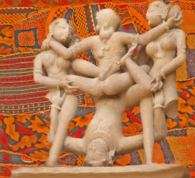stock photo of kama  - Erotic sculptures from Khajuraho India depicting positions from the Kama Sutra set against colorful Indian backgrounds - JPG