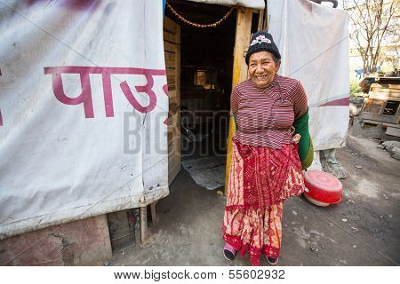 KATHMANDU, NEPAL - DEC 16: Unidentified poor women near their houses at slums in Tripureshwor district, Dec 16, 2013 in Kathmandu, Nepal. Caste of untouchables in Nepal, is about 7 % of population.