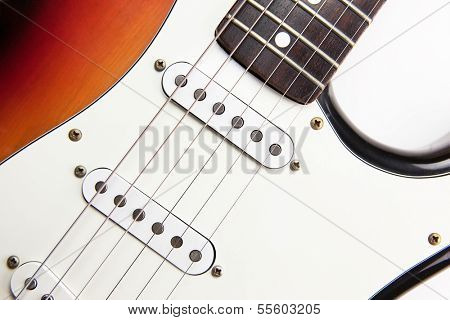 Vintage electric guitar close up, sunburst color .