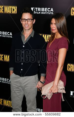 "NEW YORK-DEC 16: Actor Jeffrey Donovan and wife Michelle Woods attend the world premiere of ""Grudge Match"" at the Ziegfeld Theatre on December 16, 2013 in New York City."