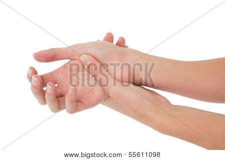 Close-up of a young woman touching her wrist on white background