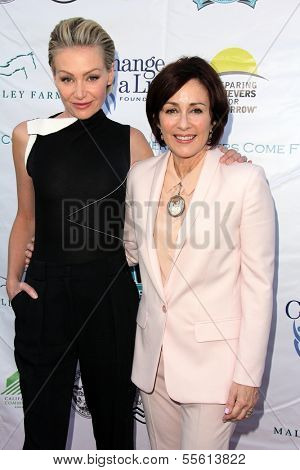 LOS ANGELES - MAY 18:  Portia de Rossi, Patricia Heaton at the 6th Annual Compton Jr. Posse Gala  at Los Angeles Equestrian Center on May 18, 2013 in Los Angeles, CA