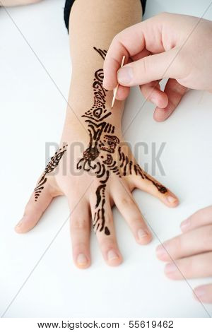 Cute Arabic girl with caligraphy ornaments on hand