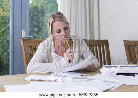 Woman looking at unpaid bills