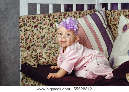 Little Girl Sitting On Couch