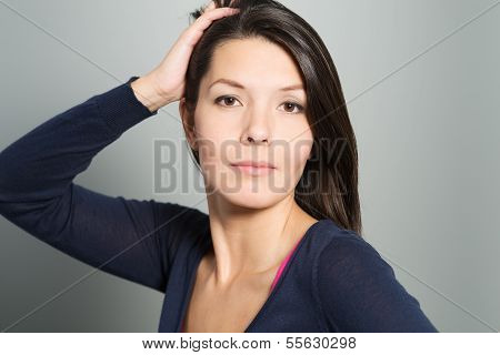 Thoughtful Attractive Woman With A Serene Face