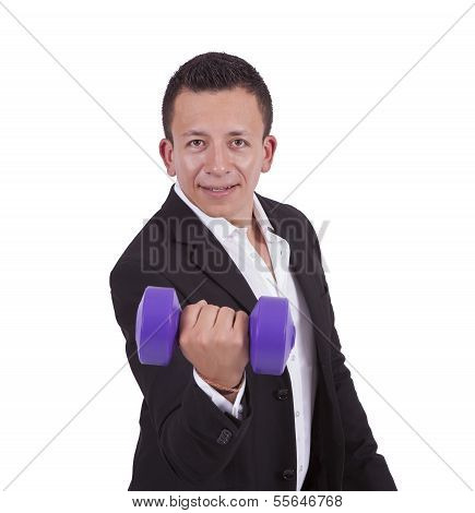 Smiling young businessman exercising with dumbbell