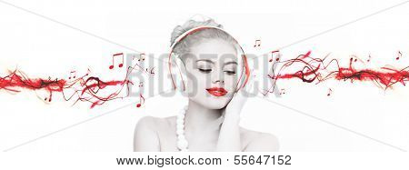 Artistic portrait of a beautiful woman wearing headphones listening to music with selective red colour and streaming music